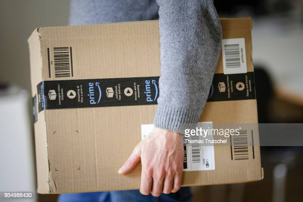 Man is holding an Amazon Prime package on March 20, 2018 in Berlin, Germany.