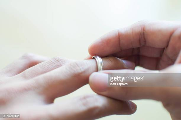 a man is holding his wedding ring - divorce stock pictures, royalty-free photos & images