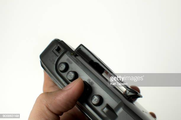 a man is holding walkman player against white background - personal stereo stock pictures, royalty-free photos & images