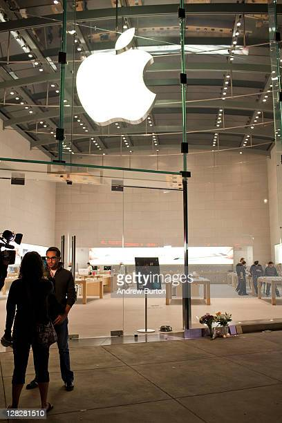 A man is interviewed by a broadcast journalist outside the Apple Store at West 66th Street on October 5 2011 in New York City Jobs passed away...