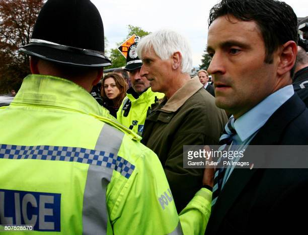 A man is led away by police as Liberal Democrat leader Nick Clegg meets supporters at the Nags Head in Malvern Worcestershire during a General...