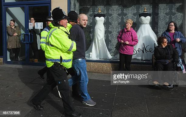 A man is led away by police officers as members of right wing movement Pegida take part in a demonstration on February 28 2015 in Newcastle upon Tyne...
