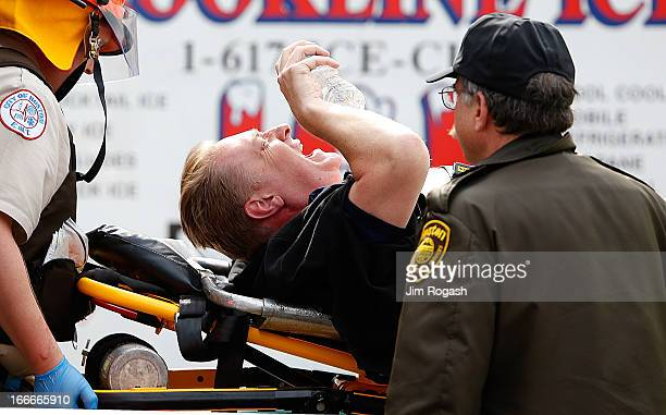 A man is loaded into an ambulance after he was injured by one of two bombs exploded during the 117th Boston Marathon near Copley Square on April 15...