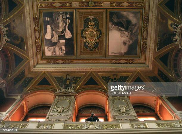 A man is looking from the upper balcony at a ceiling with a reproduction of two out of three famous paintings by Austrian painter Gustav Klimt in the...