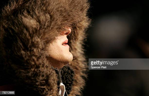 A man is partially obscured by the hood of his parka during bitterly cold weather February 5 2007 in New York City After an unusually mild December...