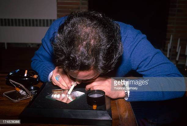 A man is photographed snorting cocaine April 21 1986 in New York City