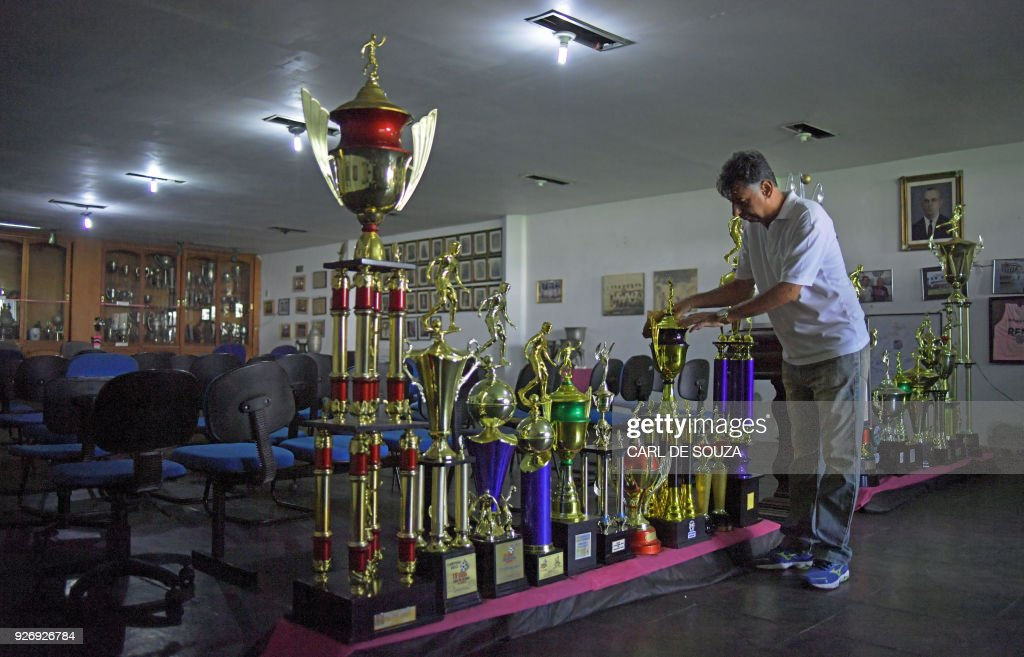 A Man Is Pictured At The Trophy Room Of Sao Cristovao Football Club In Rio