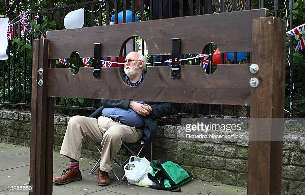 A man is pictured behind a set of stocks at a Republican street party in Red Lion square during the Royal Wedding of Prince William to Catherine...