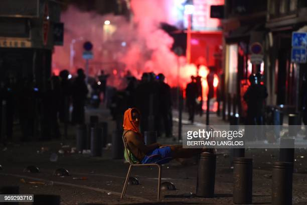 TOPSHOT A man is pictured in the Vieux Port in Marseille on May 16 after the 2018 UEFA Europa Cup Final football match between Olympique de Marseille...