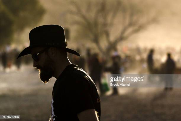 A man is pictured walking by the stage at The Birdsville Big Red Bash 2017 on July 4 2017 in Birdsville Australia
