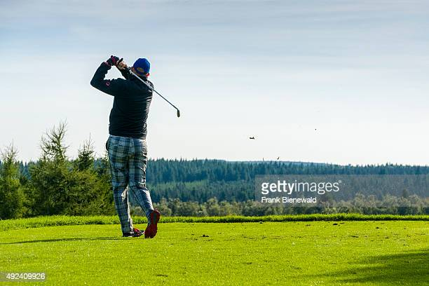 A man is playing golf on a golf course