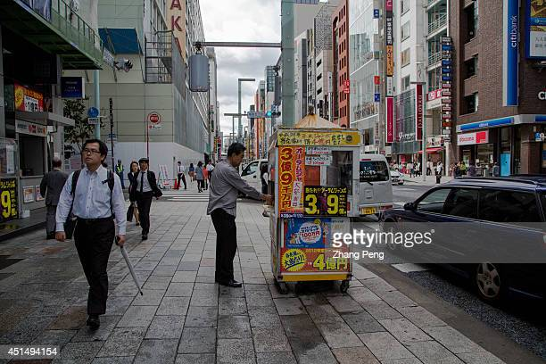 A man is purchasing his good luck from a lottery spot in Ginza To put the slump economy on a solid growth path Prime Minister Shinzo Abe's cabinet...