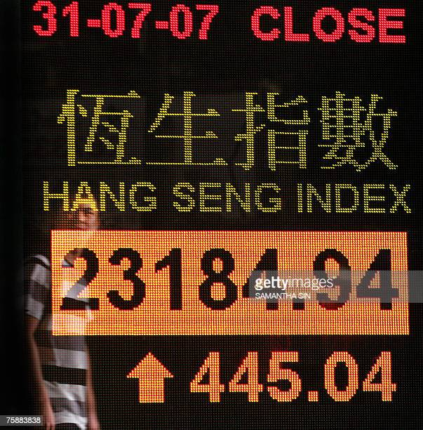 A man is reflected on a digital stock market index screen in Hong Kong 31 July 2007 Hong Kong share prices closed 196 percent higher extending their...