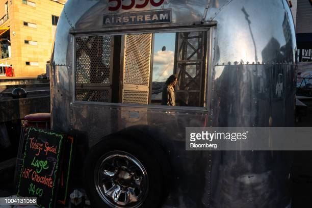 A man is reflected on a mirror of an airstream cafe in Wellington New Zealand on Wednesday July 18 2018 New Zealand inflation picked up in the second...