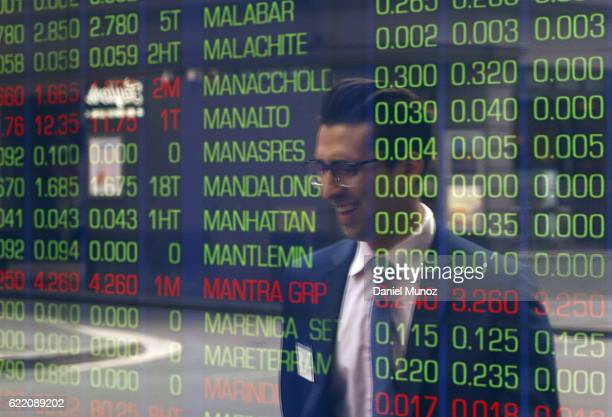 A man is reflected on a window of the Australian Securities Exchange building on November 10 2016 in Sydney Australia Americans voted yesterday to...