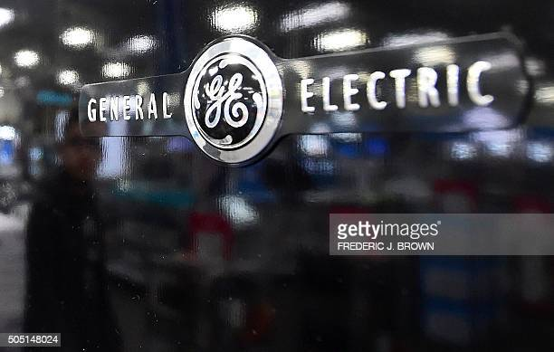 A man is reflected on the black door of a General Electric refrigerator at a store selling electronics and appliances in Montebello California on...