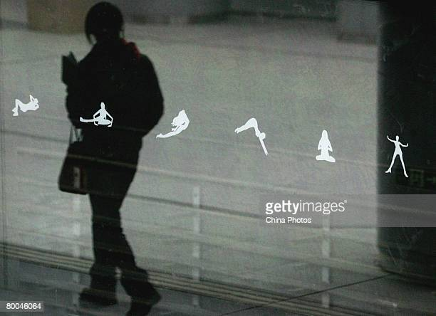 A man is reflected on the Platform Screen Door of the Olympic Park Station of the Olympic branch line of Beijing Metro on February 28 2008 in Beijing...