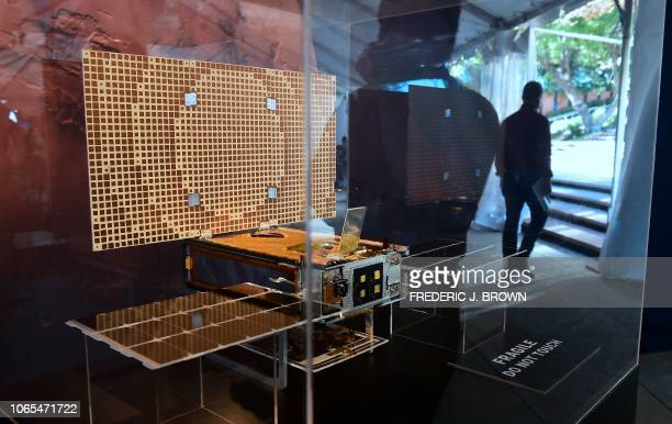 A man is reflected while viewing the MarCo one of two CubeSats launched and following the InSight marking the first time this kind of spacecraft has...