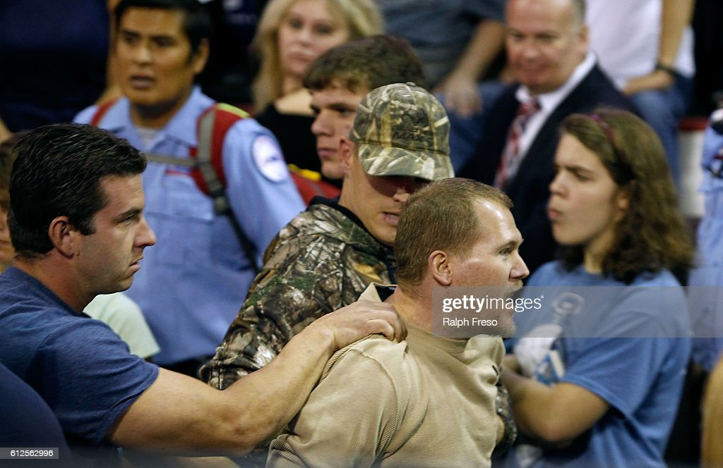 A man is removed by security after being disruptive during Republican presidential nominee Donald Trump's campaign rally on October 4, 2016 in Prescott Valley, Arizona.