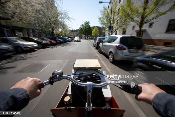 A man is riding a transportation bicycle on April 18 2019 in Berlin Germany