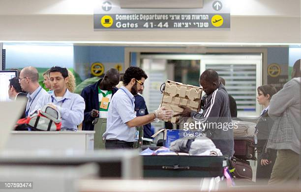 A man is screened at a security check as part of a group of 150 refugees being sent back to their native country of Sudan at the Ben Gurion Airport...