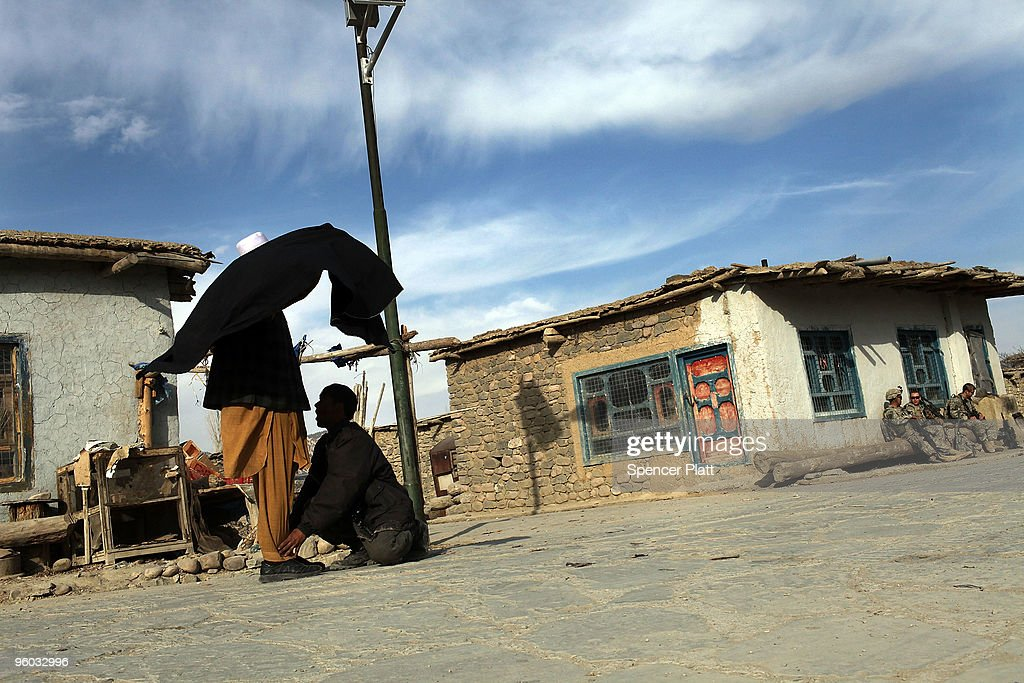 A man is searched for weapons by a member of the Afghan National Police (ANP) January 23, 2010 in Zerak, Afghanistan. Zerak, located in Paktika Province, which is roughly the size of Vermont, shares a restive and porous 600 kilometer border with Pakistan.
