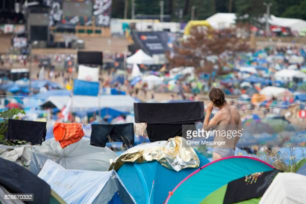 A man is seen among tents at the 2017 Woodstock Festival Poland on August 4 2017 in Kostrzyn Poland The threeday rock music festival now in its 23rd...