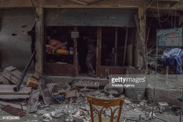 A man is seen at a damaged shop after Assad Regime's airstrikes and ground attacks to Harasta town in the besieged Eastern Ghouta in Damascus Syria...