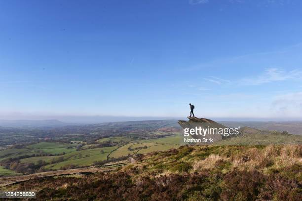 Man is seen at the Roaches in the Peak District on November 06, 2020 in Leek, Staffordshire .
