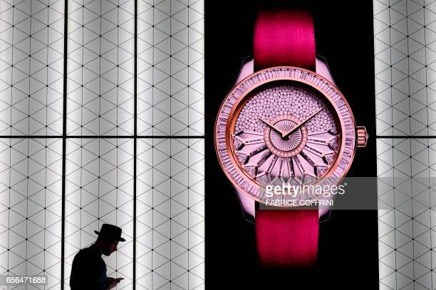 A man is seen at the stand of French watchmaker Dior during the press day of Baselworld watch and jewellery show on March 22 20017 in Basel The...