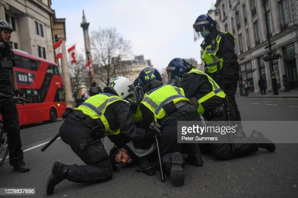 A man is seen being arrested during a protest on November 28 2020 in London England London is to return to 'Tier 2' or 'high alert' covid19...