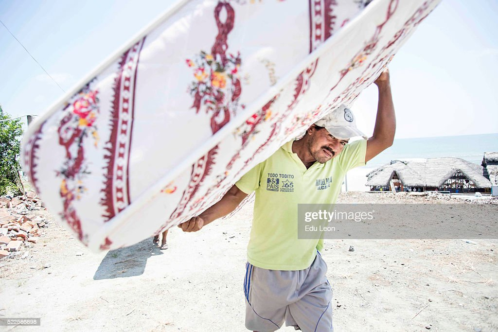 A man is seen carrying a matress after an earthquake struck in Ecuador on April 19, 2016 in Pedernales, Ecuador. At least 400 people were killed after a 7.8-magnitude quake.