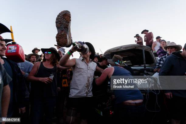 A man is seen drinking beer from his artificial leg on the wild last night of the 2017 Deni Ute Muster on September 30 2017 in Deniliquin Australia...