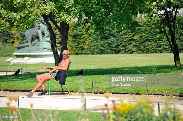 A man is seen enjoying the sun in the Jardin de Tuileries during the heatwave on July 1 2015 in Paris France France is currently experiencing a...