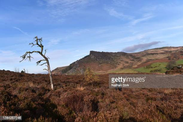Man is seen enjoying their daily exercise as they walk at the Roaches in the Peak District on November 06, 2020 in Leek, Staffordshire .