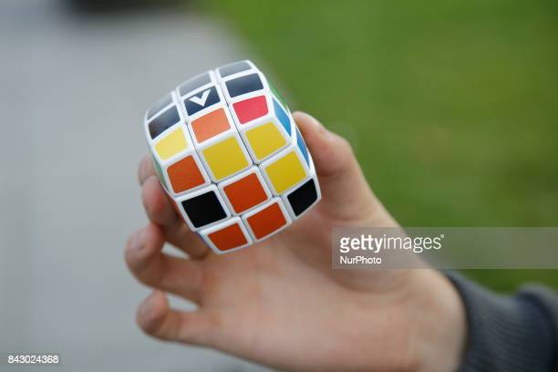 A man is seen holding a Rubiks Cube on 2 September 2017