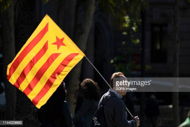 Man is seen holding an independence flag during the declaration of Quim Torra about the charges against him. The President of the Generalitat Quim...