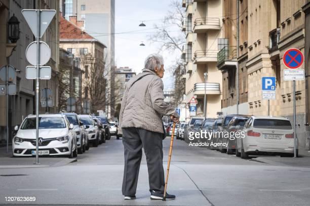 A man is seen in an empty street following coronavirus outbreakin Ljubljana Slovenia on March 18 2020
