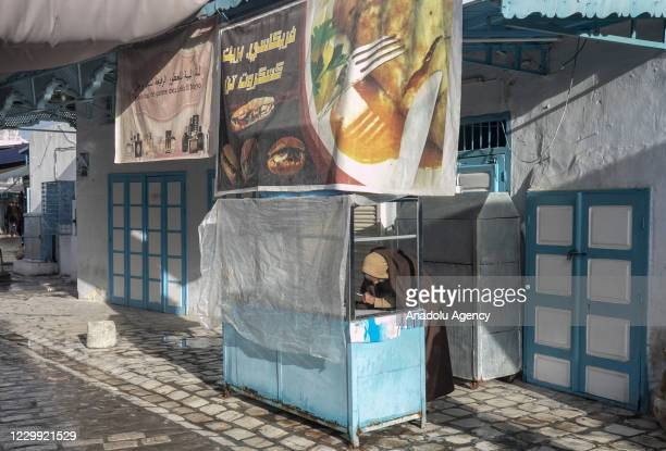 Man is seen in front of a close food stand as all tradesmen went on a strike on the call of the Tunisian General Workers Union and closed their...
