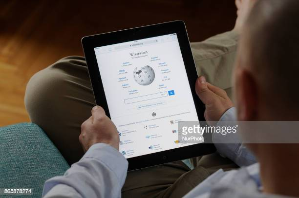 A man is seen looking at a Wikipedia page on an iPad on October 24 2017 Recently the Wikimedia foundation has announced it will give access to it's...