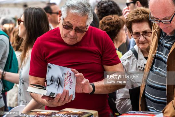 A man is seen looking at books in the stalls of the Ramblas Catalunya celebrates the 'Day of Sant Jordi' the day of books and roses Catalunya hopes...