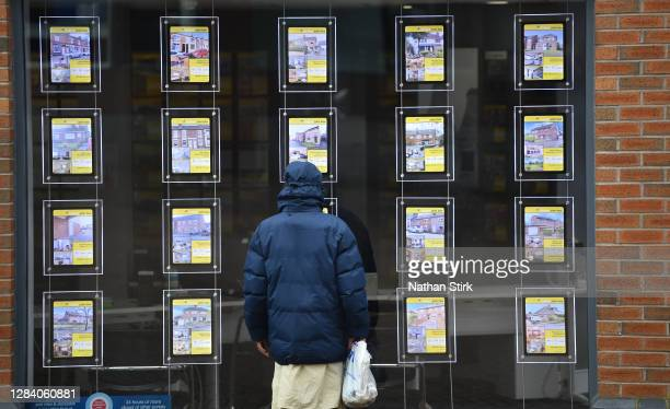 Man is seen looking at houses for sale at Butter Jon Bee's estate agents on November 05, 2020 in Stoke-on-Trent, Staffordshire, England.