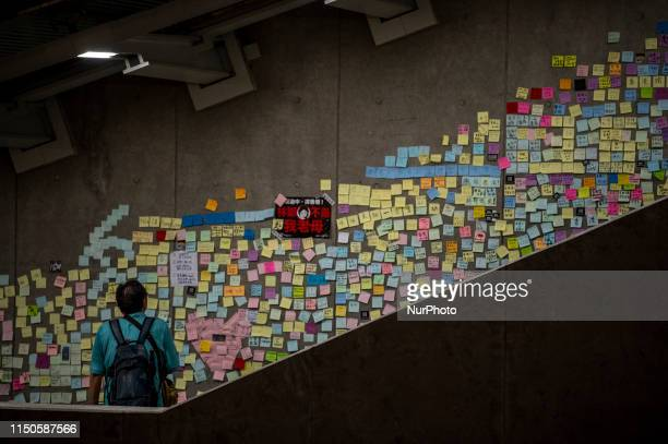 A man is seen looking at labels stuck to a wall Hong Kong China 18 June 2019