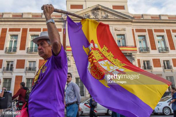 A man is seen marching against the monarchy and with the Spanish republican flag in favour of republic during the protest Around 1000 people marched...