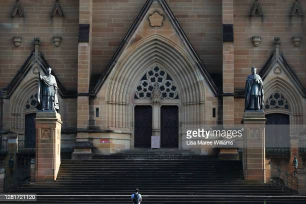 A man is seen praying outside St Mary's Cathedral on October 23 2020 in Sydney Australia Religious communities across New South Wales are welcoming...