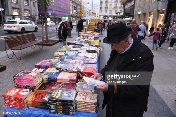 A man is seen reading a book at the Gran Vía' street ahead of the world book day celebration Tomorrow 23 April World Book Day is celebrated all over...