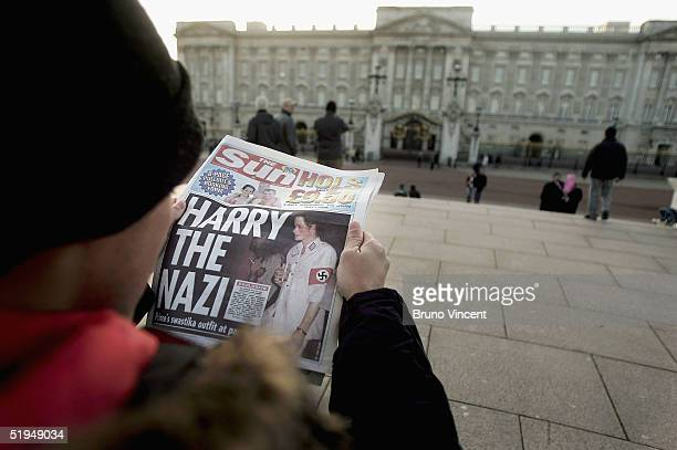 A man is seen reading a copy of The Sun newspaper in front of Buckingham Palace on January 13 2005 in London England Prince Harry made the headlines...