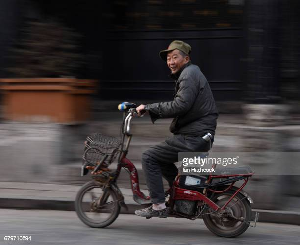 A man is seen riding his bicycle in the early morning through the streets on April 7 2017 in Pingyao China