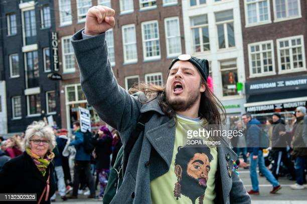 A man is seen screaming to the far right group during the demonstration Thousands of people gathered at the Dam square in the center of Amsterdam to...