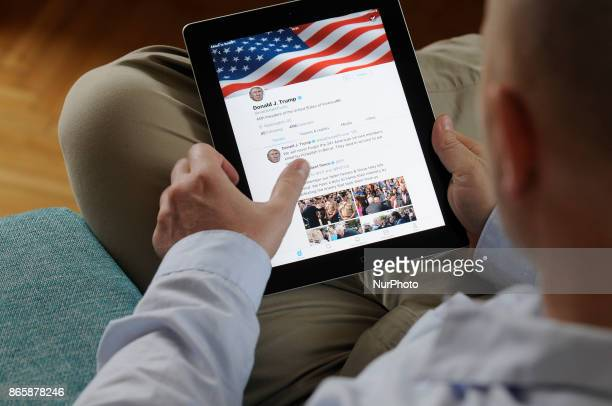 A man is seen scrolling through the Twitter timeline of US president Donald Trump on an iPad on October 24 2017
